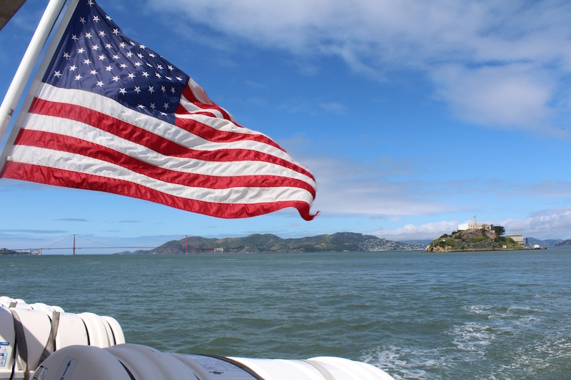 us flag, alcatraz island and the golden gate bridge