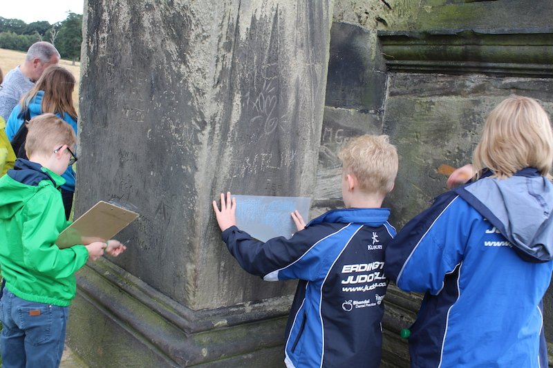 Members of the Young Archaeology Group identify and record graffiti on the Triumphal Arch