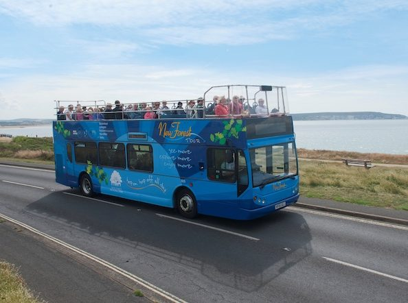 Tour guide bus travelling along the coastline