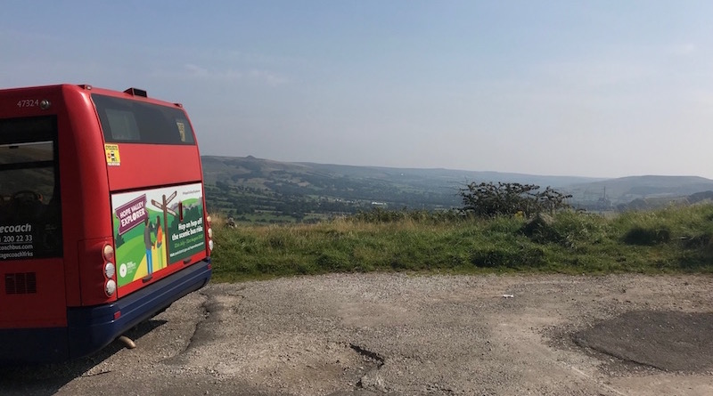 Rear of a Hope Valley Explorer bus parked up with views towards the Hope Valley